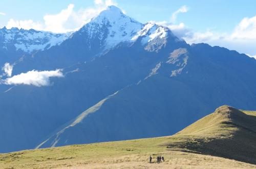 My fellow hikers dwarfed by Mount Veronica, high up in the Peruvian Andes
